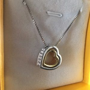 Double heart necklace. Gold and silver